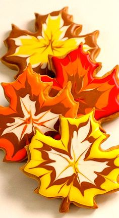 "A beautiful Thanksgiving Hostess gift of fall cookies, using an easy icing ""feathering"" technique."
