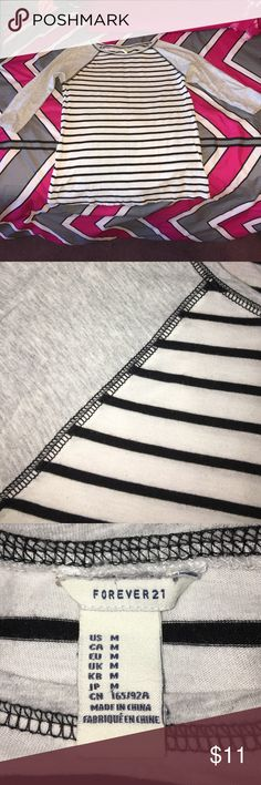 Forever 21 baseball style shirt! Forever 21 baseball style top with 3/4 length sleeve! Sleeves are light grey and middle is white with black stripes. Size medium! Forever 21 Tops