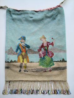 Colonial couple dancing in the sand.  Micro beaded drawstring purse.