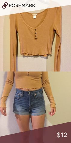 b5045cb54b9 Long Sleeved Crop Top Mustard colored crop top that has only been worn  once. Would look great with jeans and converse Tops Crop Tops