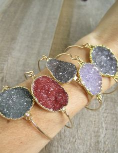 Glittering druzy gemstone is encased in gold plate and linked to a gold filled bangle to create this delicate, everyday bracelet.  $58.00
