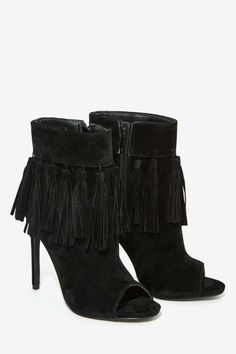 The Cortez bootie by Privileged comes n black vegan suede leather and features a stiletto heel, fringe tassels at ankle and an open toe.
