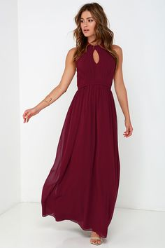 Make a stunning debut on the dance floor or in the ballroom, with the Ooh Gala-La Burgundy Maxi Dress! Burgundy chiffon shapes a high, halter neckline that fastens at back with a two-button closure and bit of elastic for fit. Keyhole accents the front of the lightly padded, pintucked bodice with hidden boning, while a sweeping maxi skirt falls effortlessly from a fitted, empire waist. Hidden zipper/hook clasp at back. Fully lined. Self: 100% Polyester. Lining: 95% Polyester, 5% Spandex. Dry…