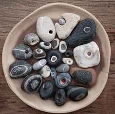 I have a lot of beach stones with circles but none with actual holes in them. these are amazing finds! From Jos van Wunnik. Pebble Stone, Pebble Art, Stone Art, Rock And Pebbles, Rocks And Gems, Crystals And Gemstones, Stones And Crystals, Stone Beads, Hag Stones