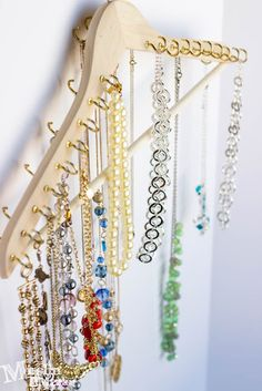 Jewelry organizer made from a wooden hanger and pack of 7/8 cup hooks!