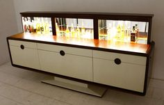A rare Rosewood Sideboard with Electric Bar like 007 | From a unique collection of antique and modern dry bars at http://www.1stdibs.com/furniture/storage-case-pieces/dry-bars/