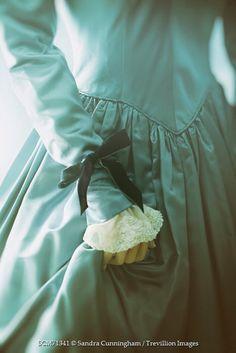 Sandra Cunningham Closeup of historical woman wearing satin dress