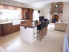 like the floor tiles and the brightness of this kitchen