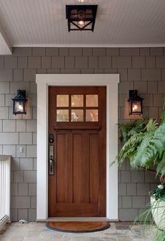 The Loma exterior lanterns flank the front door of a Santa Barbara Craftsman  Photo by Kim Reierson © DLG Lighting