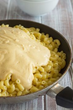 Vegan Mac and Cheese Mixing Must try this; the sauce is made with veggies, nutritional yeast, and coconut milk.