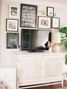 How to #decorate around a TV ? Create a Neutral gallery #wall over the #TV stand, for an exclusive look around that big black rectangle