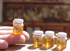 Miniature dollhouse . Honey . Flower honey . Honey in the dollhouse .On a scale…
