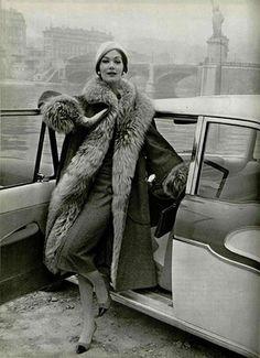 Model wearing a fur lined coat for L'Officiel, 1957.