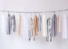 "Confetti System - Twist Rope Garland - Palette: Neutral with Silver, 12ft long. Built on a thick 1"" handmade metallic rope. Tassels range from 12-30"" long. Custom colors available. For more color options, please click purchase. $350"