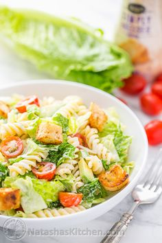 This salad has all the creamy goodness of a classic Caesar salad but is so much more exciting with the addition of pasta, avocado and tomatoes.