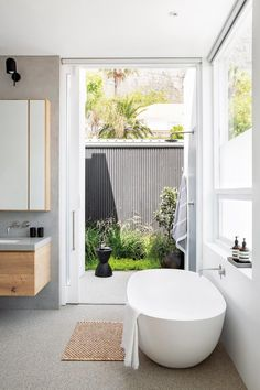 A thoughtful renovation took this Camps Bay home from old-fashioned double storey to streamlined beach bungalow with sea and mountain views. Surf House, Bay House, Renovations, Interior Cladding, Bathroom Freestanding, Open Plan Kitchen, House, Interior Inspo, Old New House