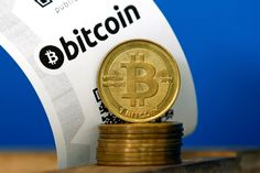 A Bitcoin (virtual currency) paper wallet with QR codes and coins. - Benoit Tessier/Reuters