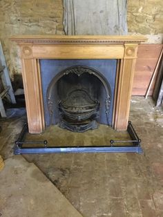 Victorian Cast Iron Fireplace with black fender and wood surround