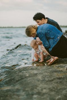 There's something about this photo...  It's real, not staged or gimmicky.  Love this Mama and Daddy, enriching their daughter's life with the sea...