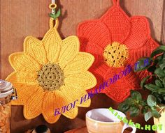 Lots of crochet potholders with diagrams.