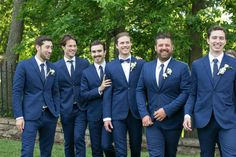The groomsmen wore blue H&M suits with blue and white polka dot ties while the groom wore a bow tie.
