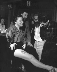 Robert Doisneau     Youki Desnos Showing Her Mermaid Tattoo, Paris     c.1950