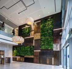 Green wall in the reception atrium at Verint Offices – Herzliya