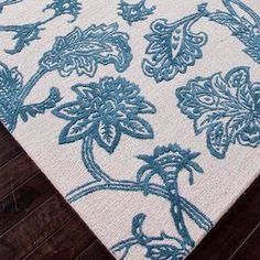 Hand-tufted wool and art silk rug with a classic floral motif.    Product: RugConstruction Material: Wool and art silkColor: Ivory and blueFeatures:  Plush pileDurableEasy careHand-tufted Note: Please be aware that actual colors may vary from those shown on your screen. Accent rugs may also not show the entire pattern that the corresponding area rugs have.