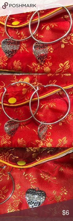 Guess earrings with detachable heart charm Worn. Hoops are a little distorted. However, the guess charms can be placed on new hoops. Guess Jewelry Earrings
