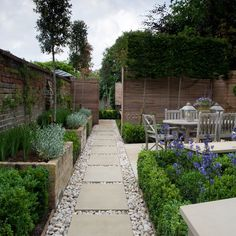 Inspiration for a small classic back formal fully shaded garden in London with a garden path and natural stone paving.