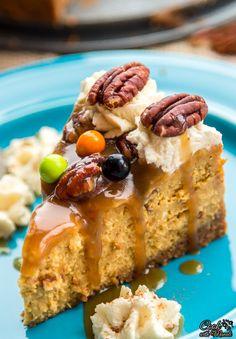 Rich, creamy Pumpkin Cheesecake with pecan praline sauce. Best Thanksgiving dessert ever!