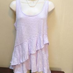 DKNY purple top Sharkbite top in a pretty lavender color.  Ruffles go down the front and back.  Great Spring piece! DKNY Tops Tank Tops