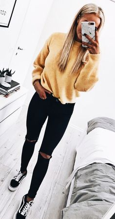 .Yellow sweater with black pants