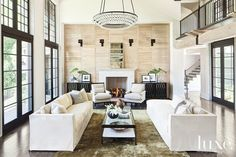 A #limestone cocktail table is the centerpiece in this #Wisconsin living room. See more at www.luxesource.com.