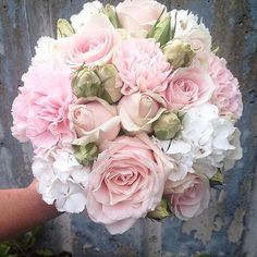 Bridal bouquet made of Sweet Avalanche by Meijer Roses.