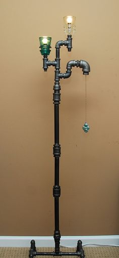 Industrial Style Floor Lamp with Pull Chain. TRoweDesigns via Etsy.
