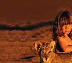 Tippi, a child of French parents born in Namibia, spent her whole childhood playing with wild animals including lion cubs, a mongoose, a snake, a cheetah, baby zebra, giraffes and crocodiles.