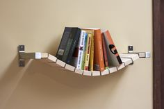 The rope bridge bookshelf lets books have a relaxed home when they're not being read. It can be rough being opened and left in all sorts of locations during the reading process and the books have earned a nice break.