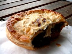 The national dish of Australia is often considered to be meat pies. Definitely try Beefy's- they're good and inexpensive!