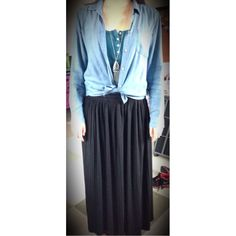 Pair a black maxi skirt with a tied chambray shirt, plain tank top, and a long necklace to accessorize! #springfashion #maxiskirt #womensfashion