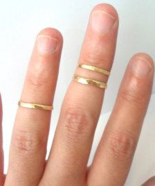 Above the knuckle, gold rings