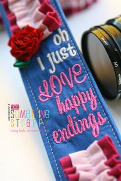 Inspired by Princess Aurora, I created this Oh, I just LOVE happy endings strap. A beautiful combination of blue and pinks, this strap is embroidered with a sweet quote from the Disney movie Sleeping Beauty, and a rose like the one held by Aurora while she was sleeping.  ~~~~~~~~~~~~~~~~~~~~~~~~~~~~~~~~~~~~~~~~~~~~~~~~~~~~~~~~~~~~~~~~~~~~~~~~~~~ This is NOT a licensed Disney product. It is an original design inspired by characters, and is handcrafted with care. Something Strappy is not…
