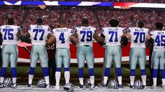 Cowboys, Cardinals lock arms for national anthem in show of unity