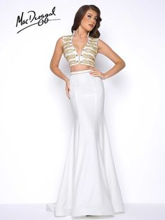Trumpet, crepe jersey, two piece, nautical inspired prom dress with deep V-neck, and beaded top. This dress comes in both Ivory/Gold and Navy.