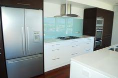 Contemporary Kitchen - Acrylic White Cabinets with Dark Oak! #LuxuryKitchen #ContemporaryKitchen #Cabinetry #Remodeling #LagunaBeach #LagunaNiguel #MissionViejo #Irvine