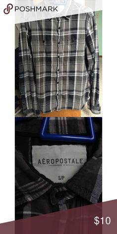 Aeropostale Black White Gray Flannel Maybe wore it once or twice. Still in perfect condition. Bought it from the guys section because I feel they have better flannels but girls can definitely wear it too. Aeropostale Shirts Casual Button Down Shirts