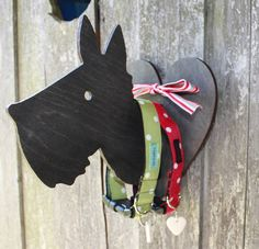 My new Heart & Hound wall plaque to grace your hallway.Perfect for hanging up the dog's collar and lead after a brisk walk. Made of charcoal stained ply, this little beauty comes flat packed and slots together easily without the need for glue or screws and includes a length of jolly ribbon as a finishing touch. The heart measures 20 x 17cms and the hound 20 x 20cms.