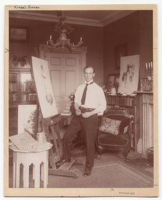 Kimball in his studio standing in front of an easel. Identification on front (handwritten): Kimball, Alonzo. Kimball, Alonzo M., 1874-1923