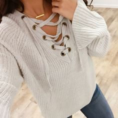    Cropped Ready For A Selfie Strap Detail Cable Knit Sweater      Blogger style at its FINEST! Everyone has been waiting not-so-patiently for the Cropped Ready For A Selfie Strap Detail Cable Knit Sweater, and we promise you its worth the wait! Perfect with leggings or tucked in with jeans! You NEED this sweater in your life. We. Promise!