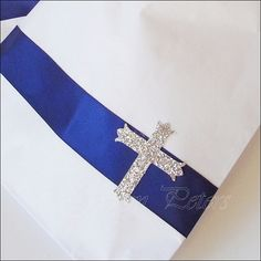 Navy blue satin ribbon and a glitter cross create the perfect Communion, Christening or Baptism party favor bags just for boys! Package your own thank you treats or use at your dessert table for a dec